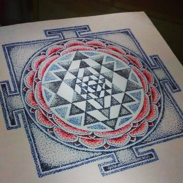 The Sacred Shri Yantra is the most well known & fascinating of all yantras because of its Intricate Geometric Harmony. It consists of 5 Interlocking Triangles, the union of five downward pointing yoni triangles (shakti) with four upward pointing fire triangles(Shiva) & is also known as the Navayoni (nine yoni) chakra. The configuration produces a pattern of forty-three triangles which represent the Goddess Tripurasundari at the center surrounded by her retinue forty-two deites. These triangles are arranged in a series of Five chakras that house one, eight, ten, ten & fourteen triangles progressively from the center outwards. The structure is enclosed by two concentric lotus circles of eight & sixteen petals enclosed within a square Bhupura or ground plan. This is one of 11 such Yantras dedicated to the Mahavidya Godesses Collection that i will be drawing up & posting starting today.  These designs are available to be commissioned on a first come, first book basis (each worth 4 hours of Tattoo time - Minimum size - 49 sq inches. Only one tattoo per design can be made. Call on +91 9833795007 to commission the Artwork
