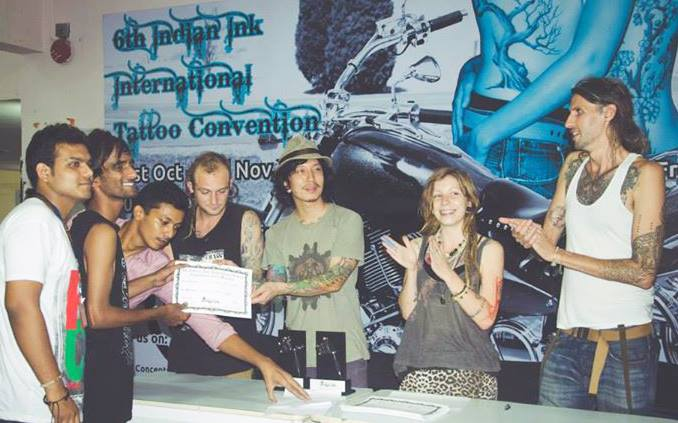 Our Student Accepting the Best Amateur Tattoo Artist Certficate during the International Tattoo Convention in Mumbai  2014